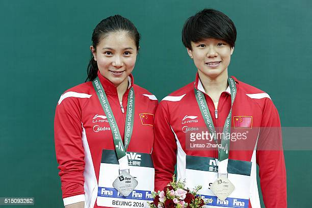 Gold medal Shi Tingmao and silver medal He Zi of China celebrates after the Women's 3m Springboard Final during day two of the FINA/NVC Diving World...