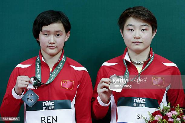 Gold medal Si Yajie and silver medal Ren Qian of China celebrate after the Women's 10m Final during day three of the FINA/NVC Diving World Series...