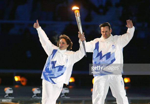 Gold medal speed skaters Bonnie Blair and Dan Jansen carry the olympic Torch towards the Olympic Flames cauldron at the Opening Ceremony of the 2002...