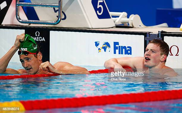 Gold medal winner Adam Peaty of Great Britain and silver medal winner Cameron Van Der Burgh of South Africa react after the Men's 100m Breaststroke...