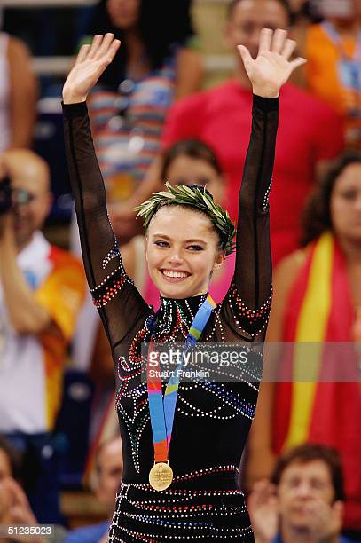 Gold medal winner Alina Kabaeva of Russia acknowledges her support during the medal ceremony for rhythmic gymnastics on August 29, 2004 during the...