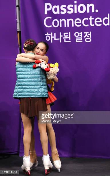 Gold medal winner Alina Zagitova of Olympic Athlete from Russia hugs silver medal winner Evgenia Medvedeva of Olympic Athlete from Russia during the...