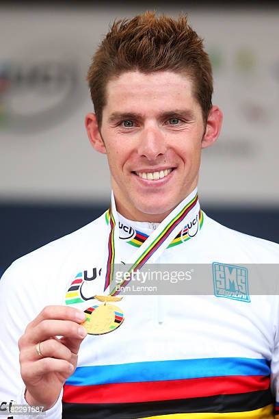 Gold medal winner and new world champion Rui Costa of Portugal celebrates on the podium after the Elite Men's Road Race a 272km race from Lucca to...