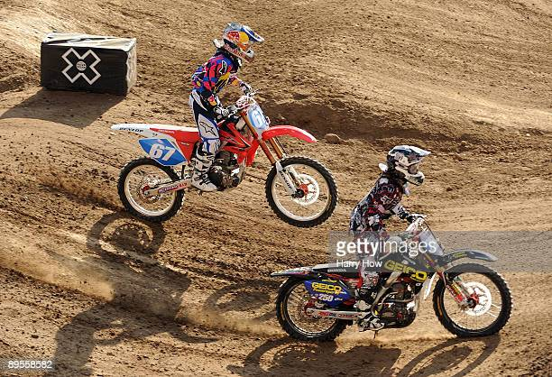 Gold medal winner Ashley Fiolek and silver medalist Jessica Patterson race in the Moto X Super X Women Final during X Games 15 at the Home Depot...
