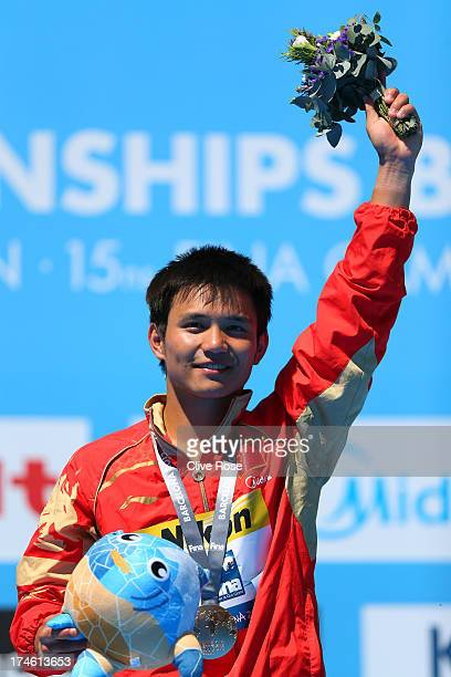 Gold medal winner Bo Qui of China celebrates after the Men's 10m Platform Diving final on day nine of the 15th FINA World Championships at Piscina...
