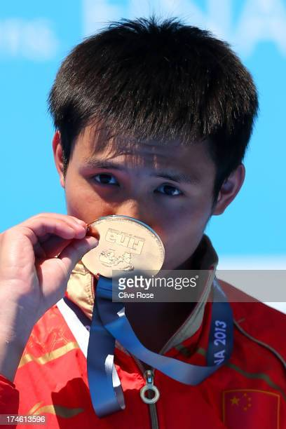 Gold medal winner Bo Qui of China kisses his medal as he celebrates after the Men's 10m Platform Diving final on day nine of the 15th FINA World...