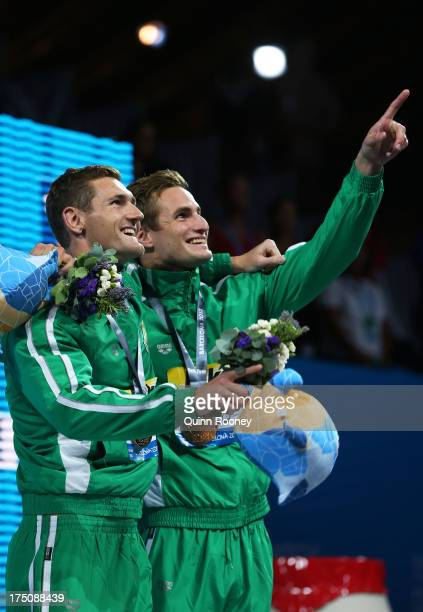 Gold medal winner Cameron Van Der Burgh of South Africa and Bronze medal winner Giulio Zorzi of South Africa celebrate together on the podium after...