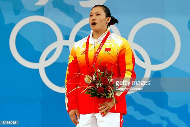 Gold medal winner Cao Lei of China stands on the podium during the medal ceremony for the women's 75kg weightlifting at the Beijing University of...