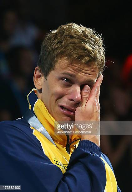 Gold medal winner Cesar Cielo Filho of Brazil cries as he celebrates on the podium after the Men's Freestyle 50m Final on day fifteen of the 15th...