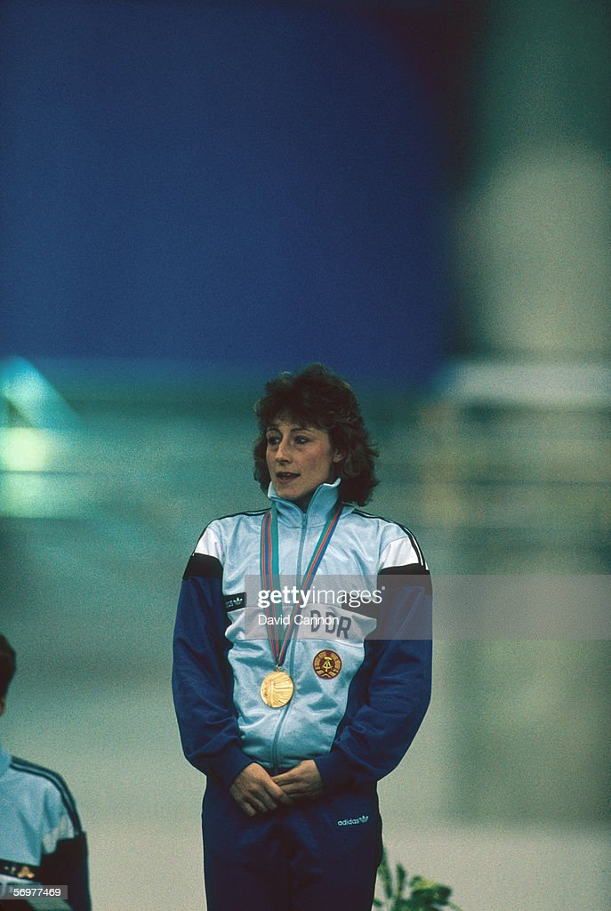 Gold medal winner Christa Rothenburger of East Germany stands on the podium during the medal ceremony for the 1000 metres Speedskating event at the 1988 Winter Olympic Games in February 1988 in Calgary, Alberta, Canada.