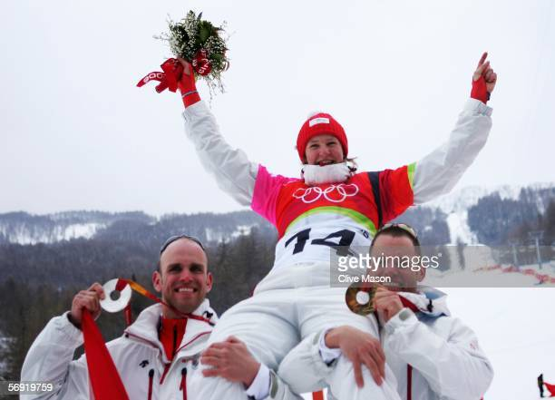 Gold medal winner Daniela Meuli of Switzerland celebrates with Men's gold medal winner Philipp Schoch and silver medal winner Simon Schoch after the...