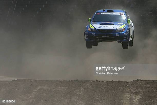 Gold medal winner drivers Travis Pastrana and Carolyn Bosley compete in the Rally Car race during the summer X Games 14 at Home Depot Center on...