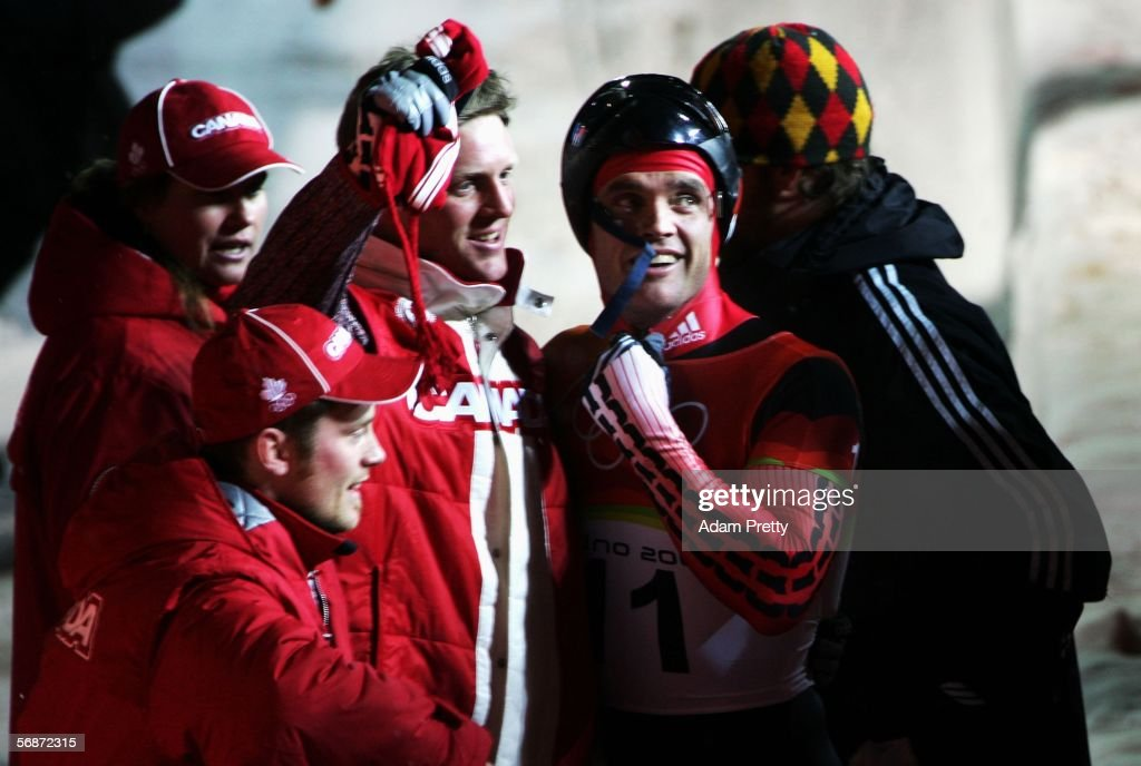 Gold medal winner Duff Gibson of Canada celebrates with team mates after the Mens Skeleton Single Final on Day 7 of the 2006 Turin Winter Olympic Games on February 17, 2006 in Cesana Pariol, Italy.