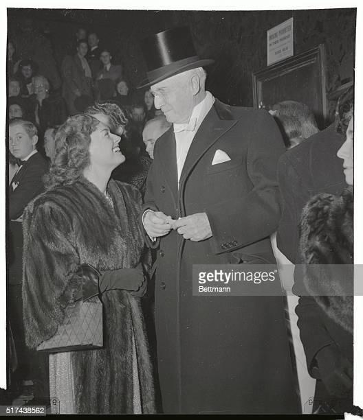 Gold medal winner Eleanor Holm arrives with American financier Bernard Baruch to attend the opening of Kern and Hammerstein's new production of Show...