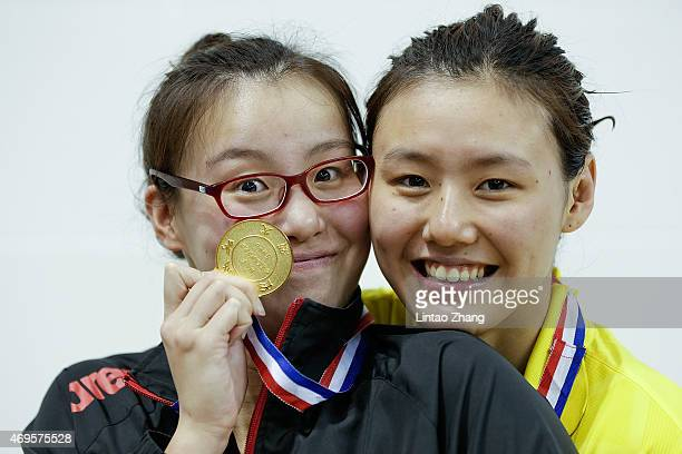 Gold medal winner Fu Yuanhui and Silver medalist Liu Xiang of China celebrate on the podium after the Women's 50m backstroke final on day five of the...