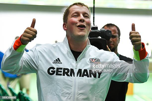Gold medal winner Germany's Christian Reitz reacts after winning the 25m Rapid Fire Pistol men's final at the Olympic Shooting Centre in Rio de...