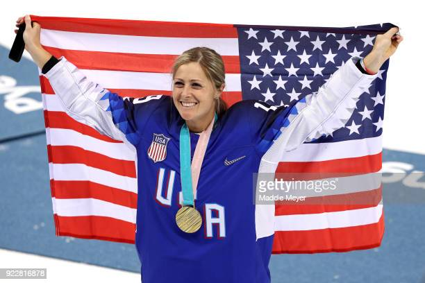 Gold medal winner Gigi Marvin of the United States celebrates during the victory ceremony after defeating Canada in a shootout in the Women's Gold...
