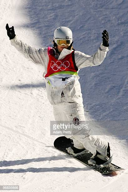 Gold Medal winner Hannah Teter of the United States celebrates after her first run in the Womens Snowboard Half Pipe Finals on Day 3 of the 2006...