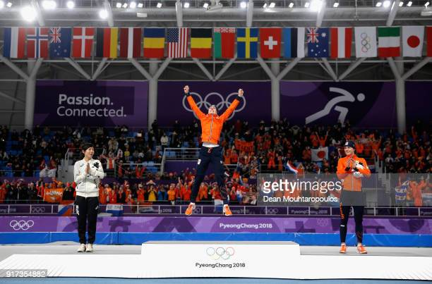 Gold medal winner Ireen Wust of The Netherlands reacts during the victory ceremony as silver medal winner Miho Takagi of Japan and bronze medal...