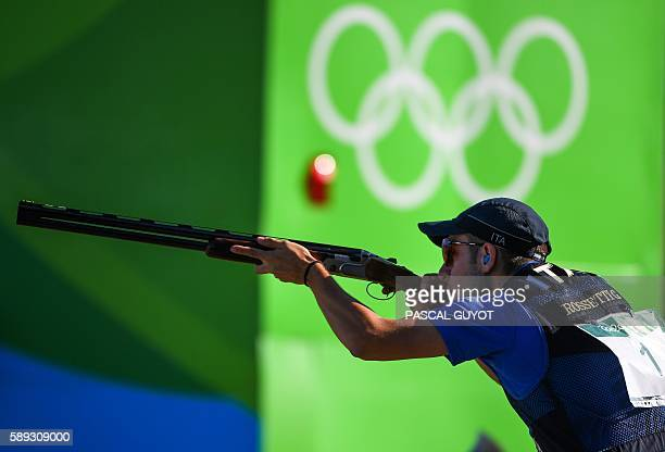 Gold medal winner Italy's Gabriele Rossetti competes during the Skeet men's final at the Olympic Shooting Centre in Rio de Janeiro on August 13...
