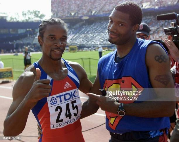 Gold medal winner Ivan Pedroso of Cuba is congratulated by silver medal winner Savante Stringfellow of the US after their event at the 8th World...
