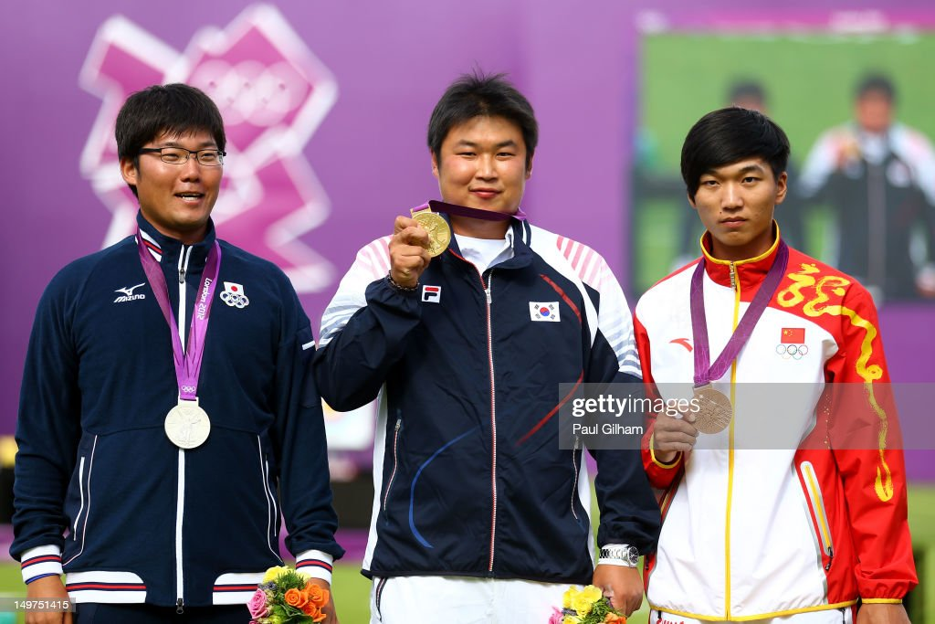 Gold Medal winner Jinhyek Oh (C) of Korea poses with Sliver Medal winner Takaharu Furukawa (L) of Japan and Bronze Medal winner Xiaoxiang Dai (R)of China after the Men's Individual Archery Gold Medal Match on Day 7 of the London 2012 Olympic Games at Lord's Cricket Ground on August 3, 2012 in London, England.