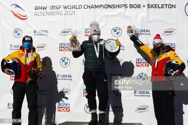 Gold Medal winner, Kaillie Humphries of the United States celebrates on the podium with Silver medalist, Stephanie Schneider of Germany and Bronze...
