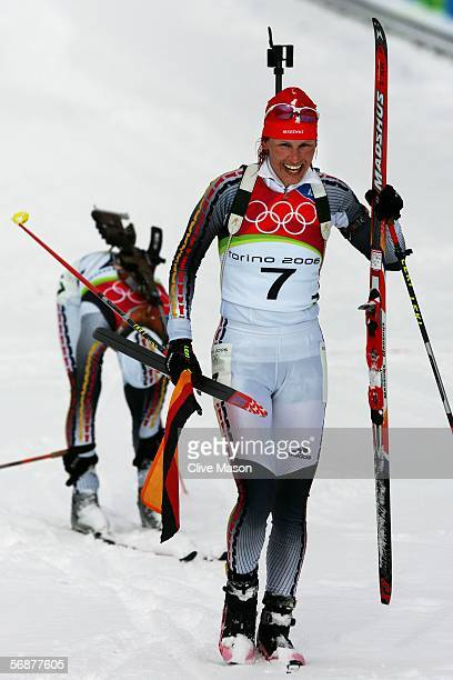 Gold Medal winner Kati Wilhelm of Germany celebrates after the Womens Biathlon 10km Pursuit Final on Day 8 of the 2006 Turin Winter Olympic Games on...