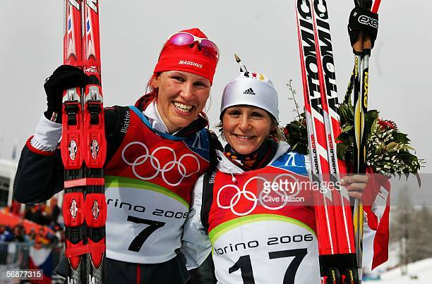 Gold Medal winner Kati Wilhelm of Germnay and Silver Medal winner Martina Glagow of Germany celebrate after the Womens Biathlon 10km Pursuit Final on...