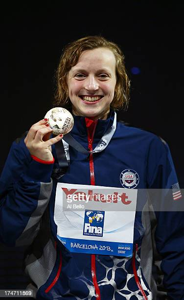 Gold Medal winner Katie Ledecky of the USA celebrates after winning the Swimming Women's400mFreestyle Final on day nine of the 15th FINA World...
