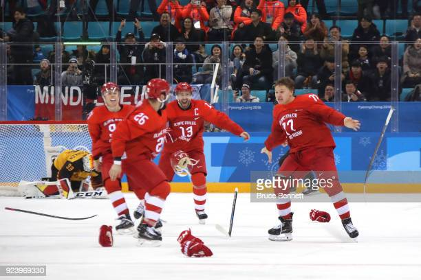 Gold medal winner Kirill Kaprizov of Olympic Athlete from Russia celebrates with teammates after scoring a goal in overtime to defeat Germany 43...