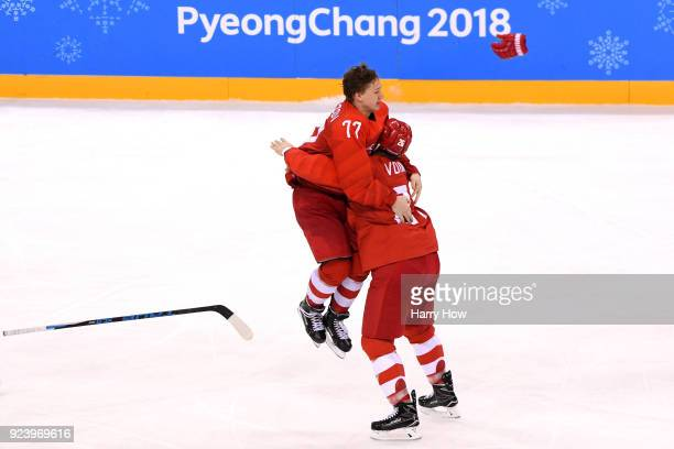 Gold medal winner Kirill Kaprizov of Olympic Athlete from Russia celebrates with Vyacheslav Voinov after scoring a goal in overtime to defeat Germany...