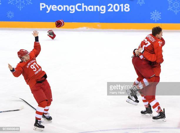 Gold medal winner Kirill Kaprizov of Olympic Athlete from Russia celebrates with Vyacheslav Voinov and Nikita Gusev after scoring a goal in overtime...