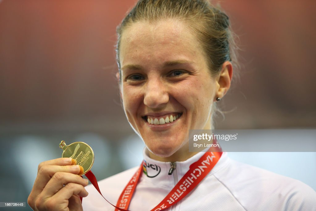 Gold medal winner Laura Brown of Canada celebrates on the podium after the Women's Points Race on day three of the UCI Track Cycling World Cup at Manchester Velodrome on November 3, 2013 in Manchester, England.