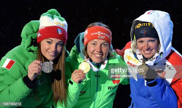 Gold medal winner Laura Dahlmeier of Germany is flanked on the podium by silver medalist Dorothea Wierer of Italy and bronze medalist Marie Dorin...