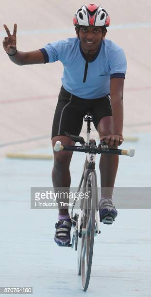 Gold medal winner Mahitha Mohan of Kerala after wining the Women 4000 meter Cycle Pursuit event competition in the ongoing 34th National Game at Mega...