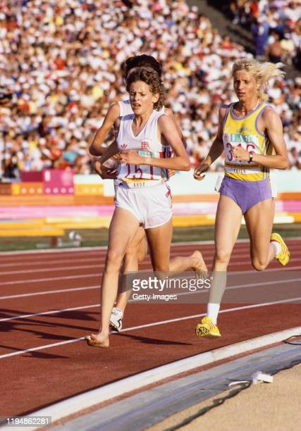 Gold Medal Winner Maricica Puica of Romania and Zola Budd of Great Britain running bare footed compete in the final of the Women's 3000 metres event...