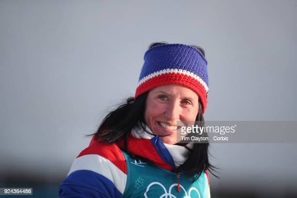 Gold medal winner Marit Bjoergen of Norway on the podium during presentations of the Cross-Country Skiing - Ladies' 30km Mass Start Classic during...