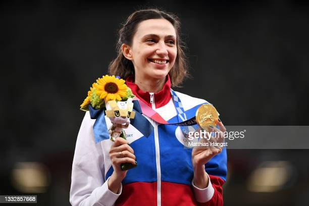 Gold medal winner, Mariya Lasitskene of Team ROC holds her medal on the podium during the medal ceremony for the Women's High Jump on day fifteen of...