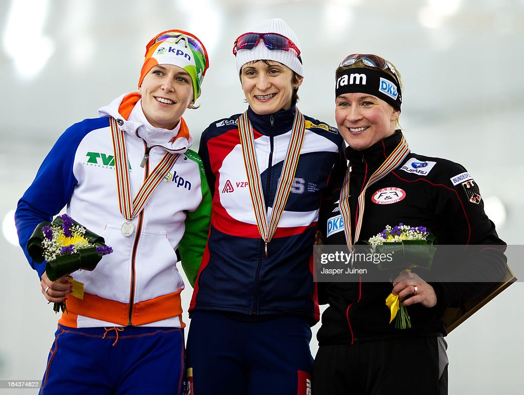 Gold medal winner Martina Sablikova (C) of the Czech Republic poses with Ireen Wust (L), silver, of the Netherlands and Claudia Pechstein (R), bronze, of Germany on the podium after the 5000m race where she won bronze on day three of the Essent ISU World Single Distances Speed Skating Championships at the Adler Arena Skating Center on March 23, 2013 in Sochi, Russia.