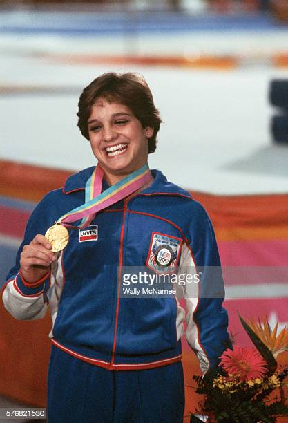 Gold medal winner Mary Lou Retton poses for a photograph after the awards ceremony for the Women's Gymnastics Combined event at the 1984 Los Angeles...