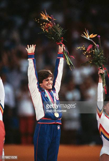 Gold medal winner Mary Lou Retton raises her arms in victory at the awards ceremony for the Women's Gymnastics Combined event at the 1984 Los Angeles...