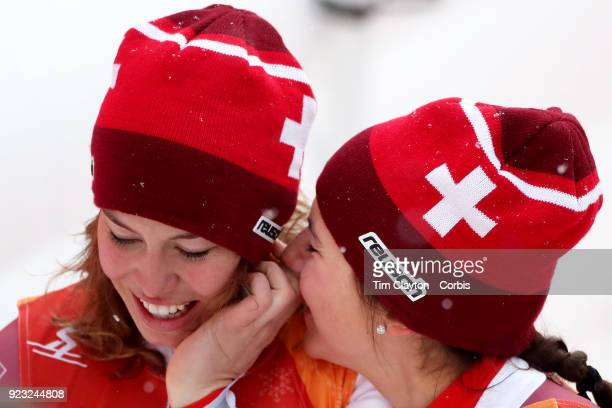 Gold medal winner Michelle Gisin from Switzerland is congratulated by bronze medalist Wendy Holdener from Switzerland as the result is confirmed...