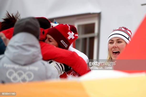 Gold medal winner Michelle Gisin from Switzerland is congratulated watched by Silver medal winner Mikaela Shiffrin of the United States after the...