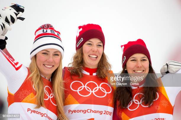 Gold medal winner Michelle Gisin from Switzerland with silver medalist Mikaela Shiffrin of the United States and bronze medalist Wendy Holdener from...