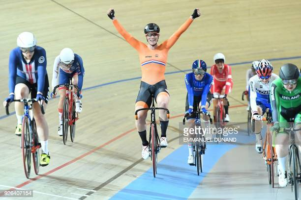 Gold medal winner Netherland's Kirsten Wild celebrates winning the women's omnium during the UCI Track Cycling World Championships in Apeldoorn on...
