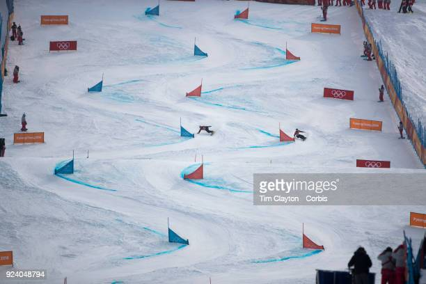Gold medal winner Nevin Galmarini #12 of Switzerland in action against Sangho Lee of Korea in the final of the Men's Snowboard Parallel Giant Slalom...