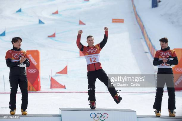 Gold medal winner Nevin Galmarini of Switzerland on the podium with silver medal winner Sangho Lee of Korea and bronze medal winner Zan Kosir of...