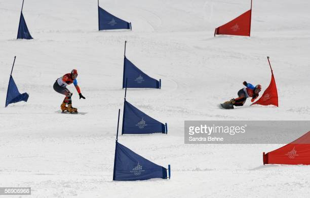 Gold Medal winner Philipp Schoch of Switzerland and Silver Medal winner Simon Schoch of Switzerland compete in the Mens Snowboard Parallel Giant...