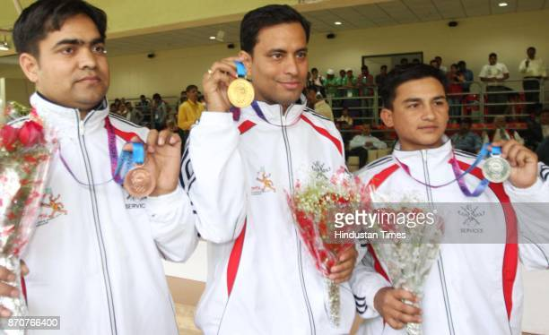 Gold medal winner Sanjeev Rajput of Services Silver medal winner Satendra Singh of Services and Bronze medal winner Imran of Services showing their...